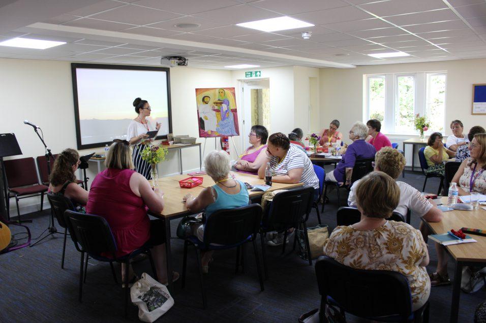 women sat at tables listening to Girls' Brigade speaker