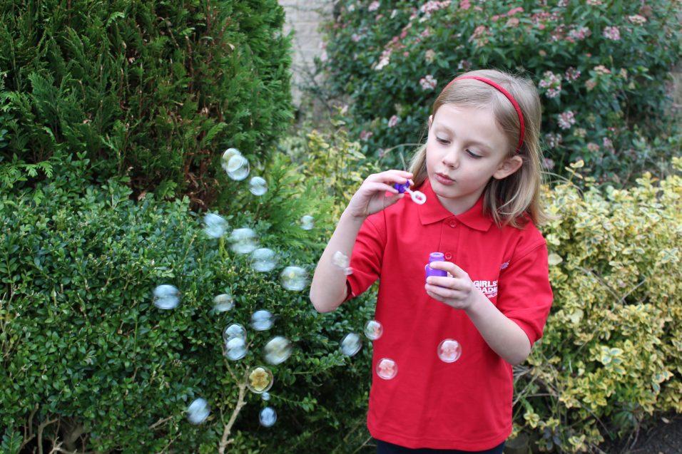 n:vestigate girl blowing bubbles