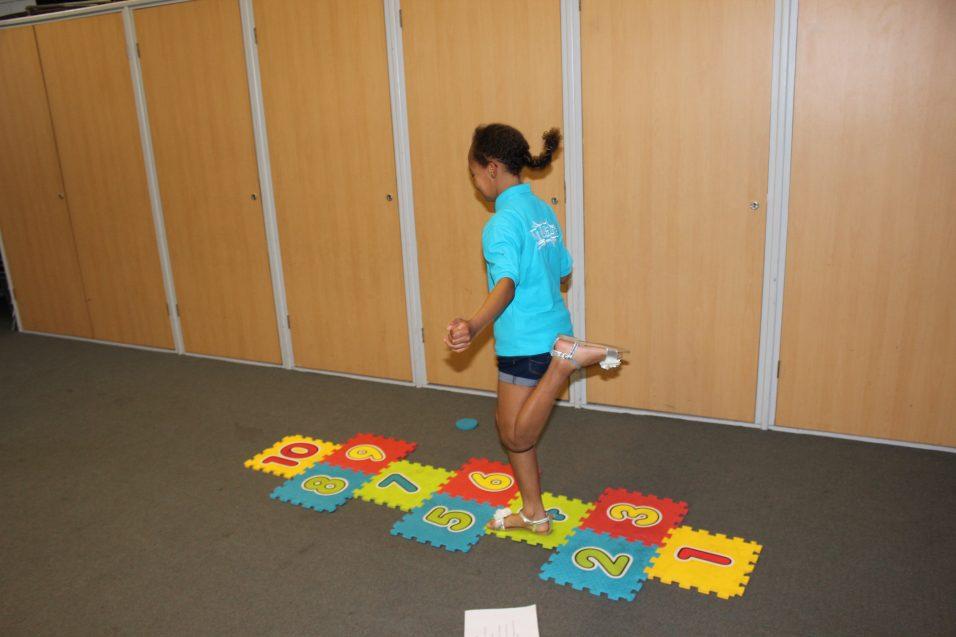 n:gage girl playing hopskotch