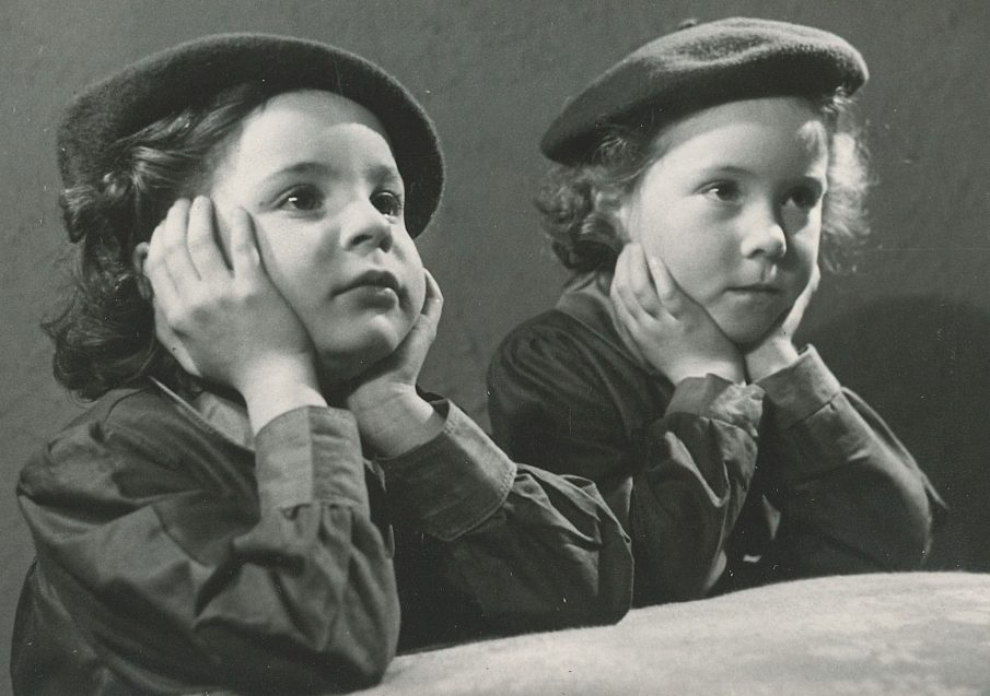 two young Girls' Guildry girls with chins in hands listening - black and white photo