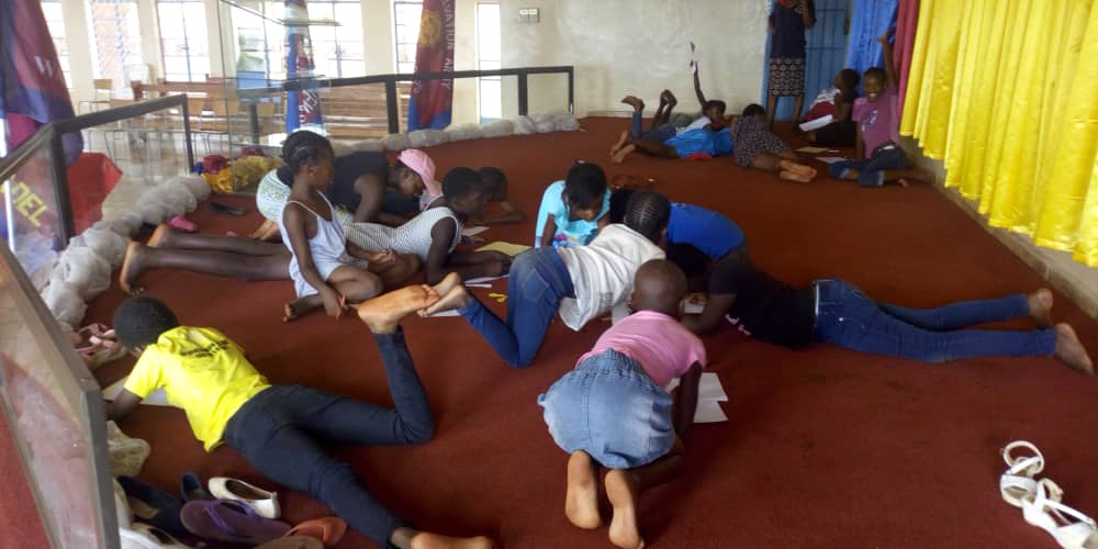 Girls' Brigade in Zimbabwe playing and learning on the floor