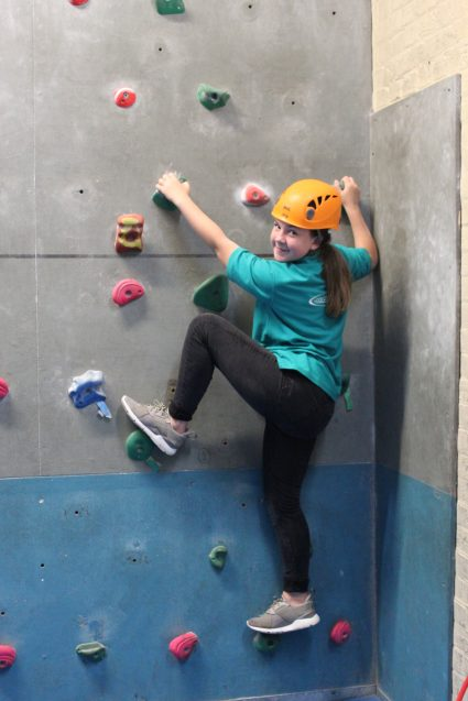 n:counta girl climbing on climbing wall