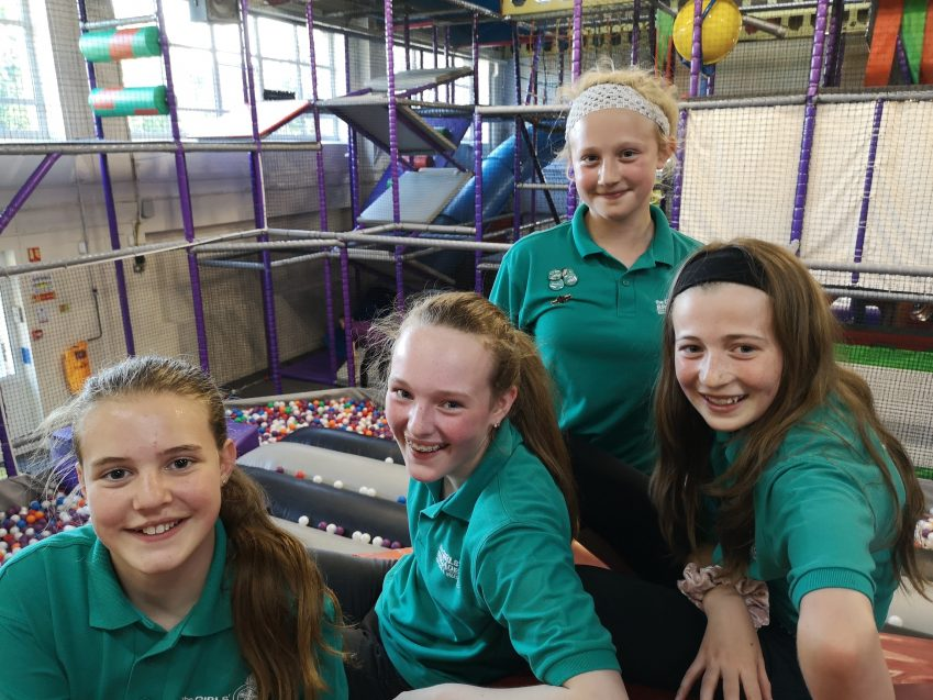 four n:counta girls smiling at camera in soft play area