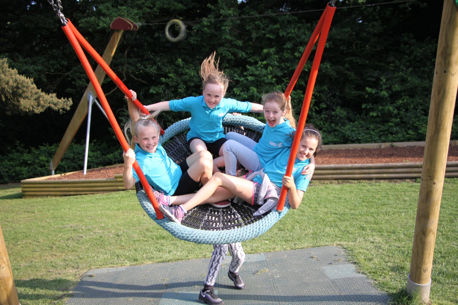 four n:gage girls in large park swing