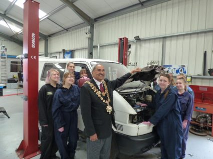 young women from 35th birmingham girls brigade group with the van they are renovating and the mayor