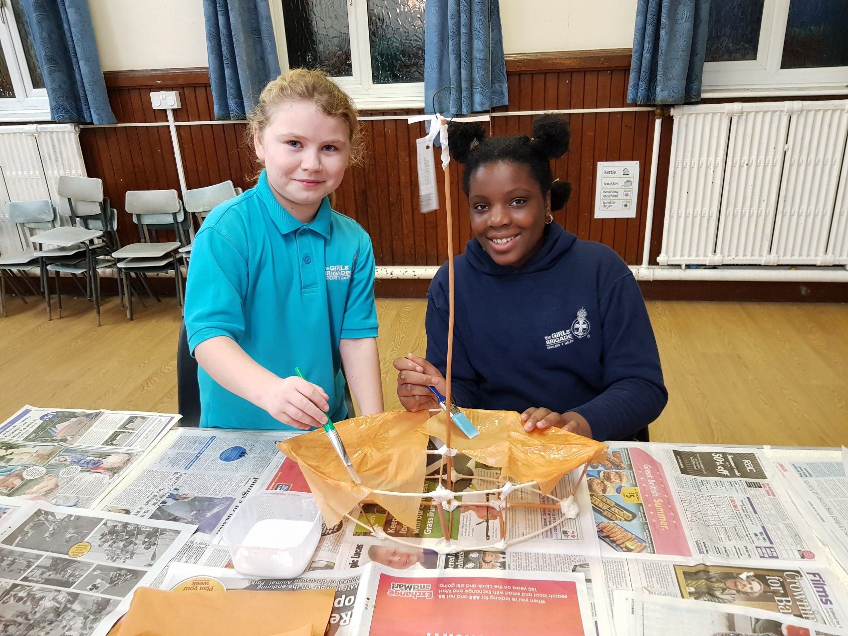 Young girls making a boat lantern craft
