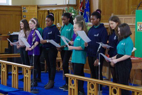 Teenage GB members singing in a church