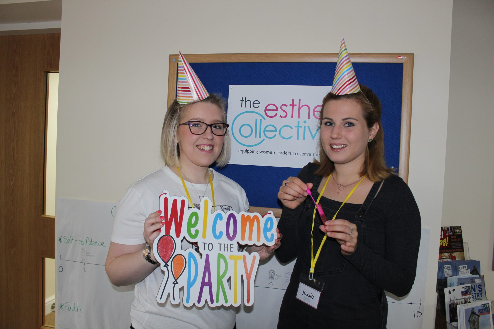 Young women in party hats at Esther Collective
