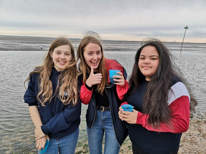 3 teens on beach