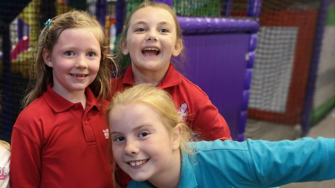 three girls in soft play area