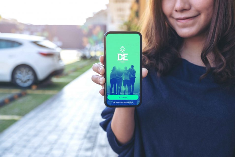 young person on phone with dofe app