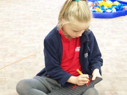 n:vestigate girl sewing