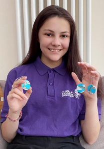Jessica Smith with her keyrings fundraising for the NHS