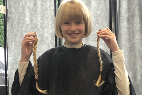 GB member holding donated hair