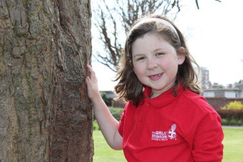 n:vestigate girl stood by tree