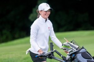 Photo of Emma Gourley with golf trolley