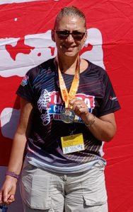 Janice with half-marathon medal