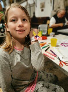 Girl showing a butterfly bracelet craft